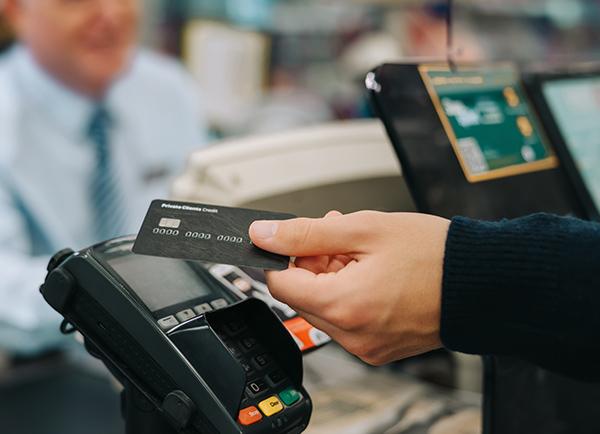 Processing card at a POS terminal.